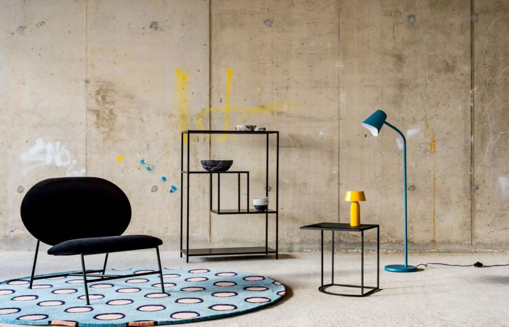 London Design Festival 2018 - Chair, rug, shelving and lights displayed in minimalist concrete setting.